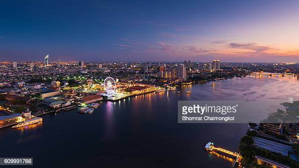 Bangkok cityscape in the business district along with the Chao Phraya river at twilight time, Thailand
