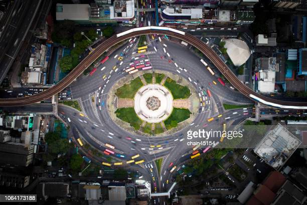 bangkok eye aerial view of victory monument during twilight with long exposure of light at bangkok, thailand. - high section stock pictures, royalty-free photos & images