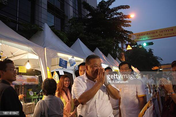 Bangkok Governor MR Sukhumbhand Paribatra greets people on a street during an opening ceremony of the Chinese Vegetarian Festival in Bangkok's...