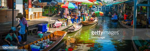 bangkok locals at colorful floating market river boats panorama thailand - floating market stock pictures, royalty-free photos & images