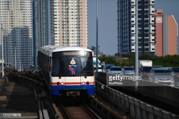 Bangkok Mass Transit System sky train arriving Saphan Taksin station during rush hour in the morning on May 12, 2020 in Bangkok, Thailand.