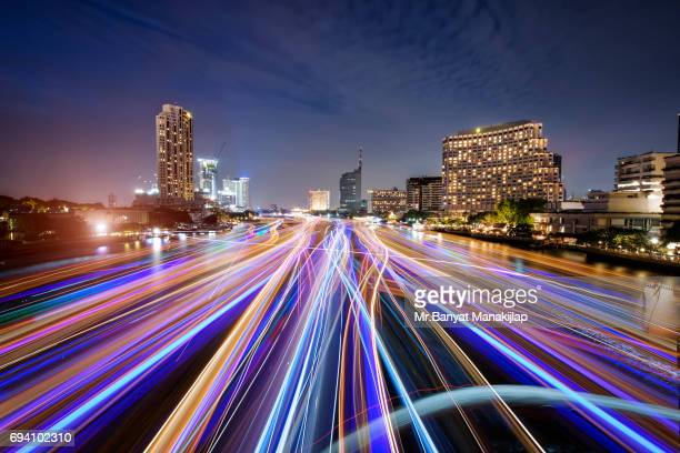 Bangkok night view with ship light trail of Chao Praya river,Bangkok,Thailand