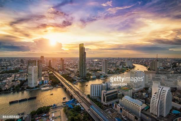 Bangkok river view at sunset with modern business building along the Chao Phraya river, Bangkok is beautiful city in Southeast Asia. Bangkok , Thailand.