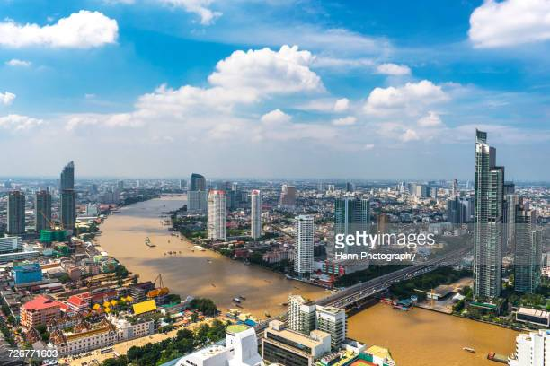 bangkok skyline with the chao phraya river - シーロム ストックフォトと画像
