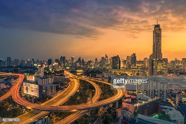 bangkok skylines and expressways at dusk - association of southeast asian nations stock photos and pictures
