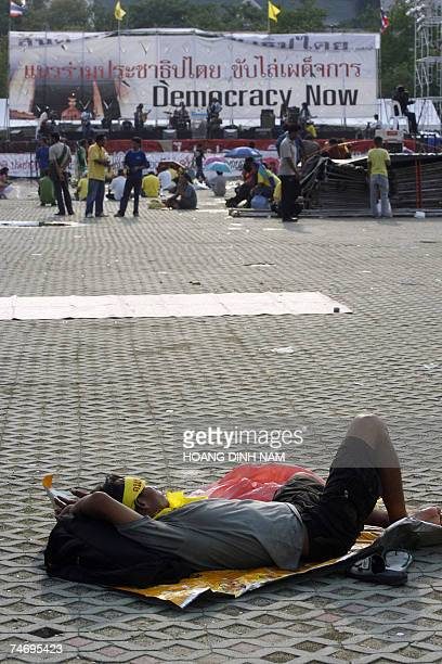 Demonstrator takes a nap at Sanam Luang square before the nightly pro-democracy demonstration, held 18 June 2007 in Bangkok, to protest against the...
