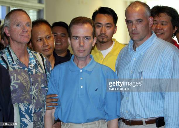 A picture dated 17 August 2006 shows US teacher John Mark Karr flanked by US and Thai security officials at the Thai Immigration Department in...