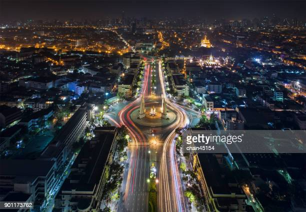 Bangkok Thailand aerial view skyline of democracy monument at night with transportation in business area.