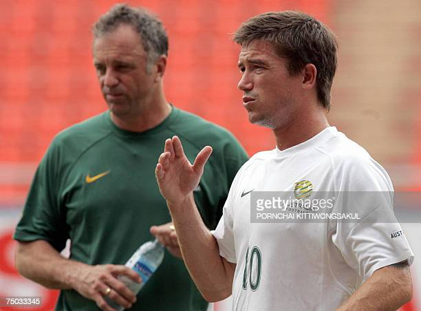 Australia football player Harry Kewell talks next to his coach Graham Arnold during practice for the Asian Cup 2007 tournament in Bangkok 05 July...