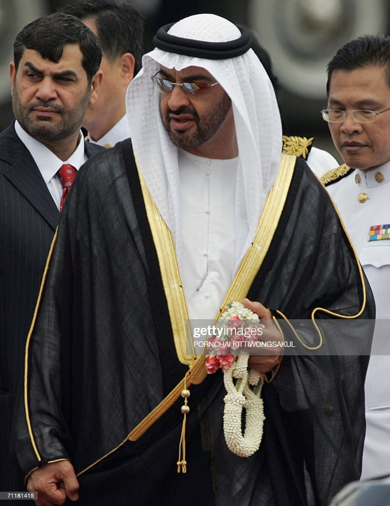 Crown Prince of Abu Dhabi, Sheikh Mohammed Bin Zayed Al Nahyan of United Arab Emirates (C) walks among Thai hosts during the welcoming ceremony at the Royal Military airport in Bangkok, 12 June 2006. Sheikh Mohammed is here to attend Thai King Bhumibol Adulyadej's 60th anniversary to throne. Kings and queens, sultans and princes from 25 countries gathered in Thailand to celebrate 60 years on the throne for King Bhumibol Adulyadej, the world's longest-serving monarch.