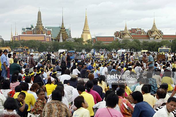 Demonstrators sit on Sanam Luang square, listening to speeches during a pro-democracy rally held late 19 June 2007, in Bangkok to protest against the...