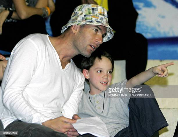 French football legend Zinedine Zidane talks with his son Luca at a Thai boxing match at a boxing stadium in Bangkok 19 February 2007 Zidane whose...