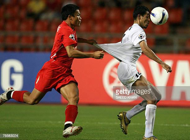 Iraqi forward Younis Mahmoud vies with Vietnamese player Pham Hung Dung for the ball during the Asian Football Cup's quarter final at the...