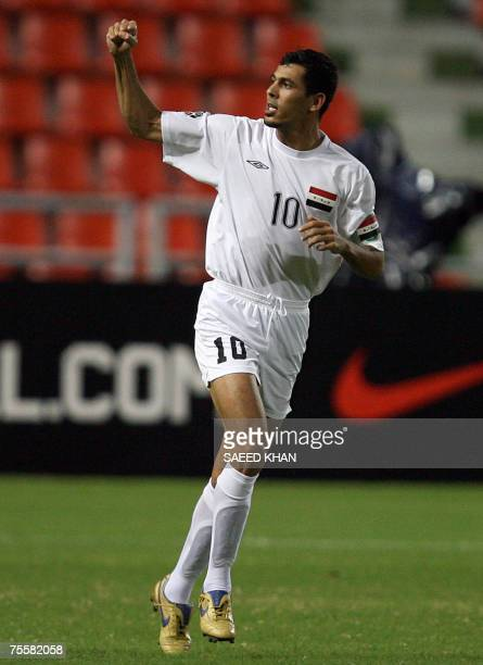 Iraqi striker Younis Mahmoud celebrates his first goal against Vietnam during the Asian Football Cup's quarter final at the Ratchamangla Stadium in...