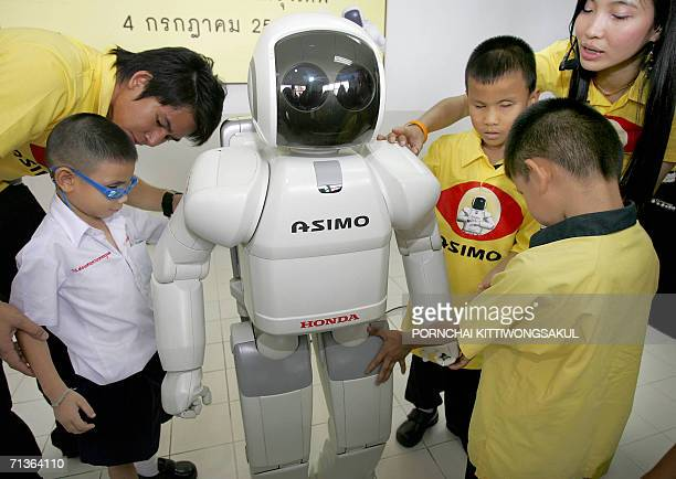 Japanese automaker Honda Motor's humanoid robot 'Asimo' is displayed for blind children at the Bangkok school for the blind 04 July 2006 Asimo...