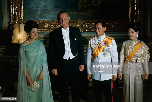 Bangkok, Thailand: President and Mrs. Lyndon B. Johnson pose with King Bhumibol and Queen Sirikit before the start of a formal dinner in the Chakri...