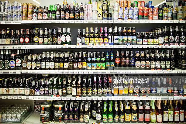 Bangkok, Thailand. Shelves in a supermarket full of imported beer bottles.