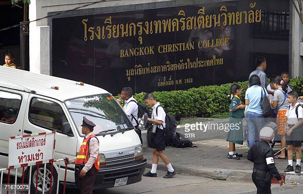 Students wait for their tranportation outside the Bangkok Christian College where US teacher John Mark Karr had began to teach before his arrest by...