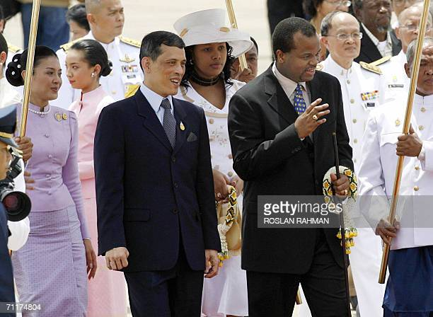 Swaziland King Mswati III and Queen Inkhosikati LaDube are greeted by Thai Crown Prince Maha Vajiralongkorn and Princess Srirasmi upon arrival at the...