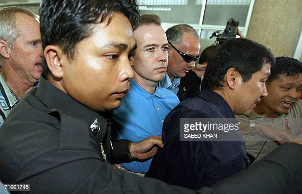 Thai and US officials take away US teacher John Mark Karr to a detention cell from the middle of a press conference at the Thai Immigration...