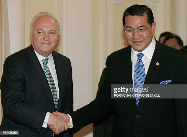 Thai deputy Prime Minister Surakiart Sathirathai shakes hands with Spanish Foreign Minister Miguel Angel Moratinos at the Government House in Bangkok...