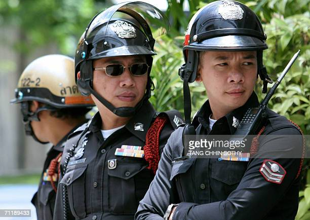 Thai policemen stand guard outside a hotel where royal guests staying in Bangkok, 13 June 2006. Royalty from across Asia, Europe, the Middle East and...