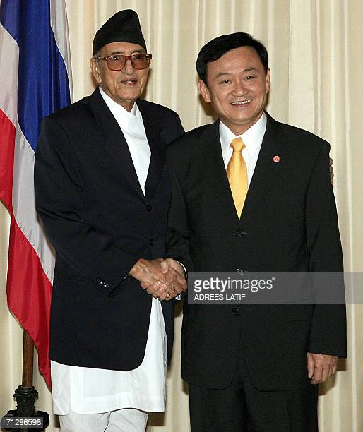Thai Prime Minister Thaksin Shinawatra shakes hands with with Nepal's Prime Minister Girija Prasad Koirala at Government House in Bangkok 26 June...