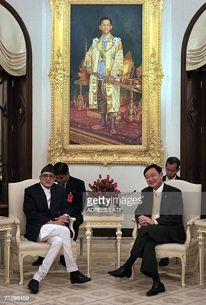 Thai Prime Minister Thaksin Shinawatra talks with with Nepal's Prime Minister Girija Prasad Koirala at Government House in Bangkok 26 June 2006...