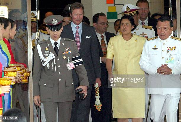 Thai Princess Maha Chakri Sirinthorn escorts Grand Duke Henri of Luxembourg as arrives to participate in the celebrations of Thai King Bhumibol...