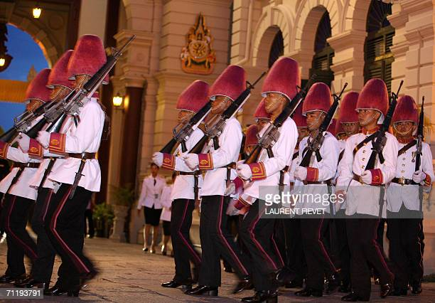 Thai Royal guards wearing pink to welcome foreign monarchs, march to take position prior to the arrival of royalty at the Grand Palace in Bangkok, 13...