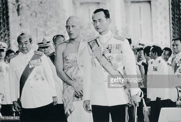 The Americanborn king of Thailand Bhumibol Adulyade leads his only son Crown Prince Vajiralongkorn into Bangkok's glittering temple of the Emerald...