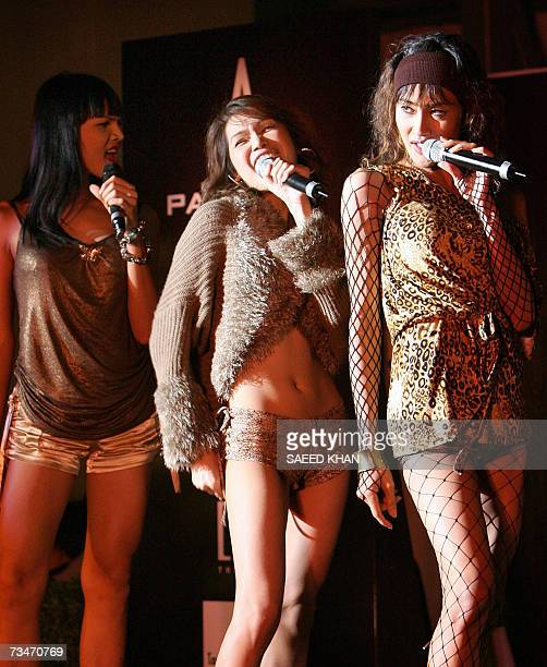 TO GO WITH AFP STORY AFPEntertainmentThailandmusicschedFEATURE Members of Venus Flytrap a ladyboy band modeled on the Spice Girls perform at a stage...