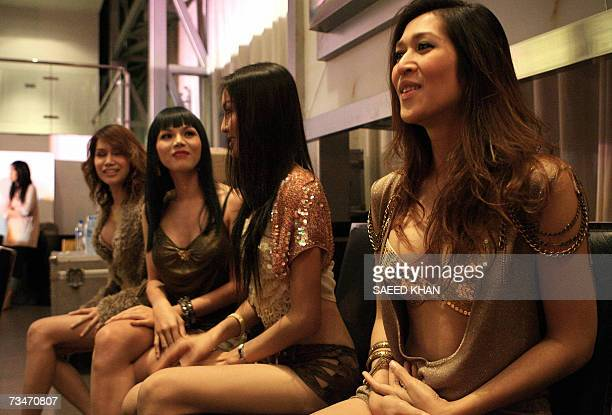 TO GO WITH AFP STORY AFPEntertainmentThailandmusicschedFEATURE Members of Venus Flytrap a ladyboy band modeled after the Spice Girls wait backstage...
