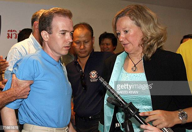 US officials take away US teacher John Mark Karr as Ann Hurst an attache for the US Department of Homeland Security looks on in the middle of a press...