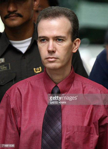 US teacher John Mark Karr walks towards a van on his way to the airport from a detention center at the Thai Immigration Department in Bangkok 20...