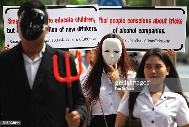 BangkokThailand Youth Network and Parents wear masks and raise labels message protesting the company of liquor in front of the British embassy in...