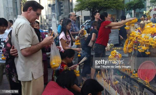 Bangkok,Thailand,Sun.,Feb. 29, 2004--St. Paul Mayor Randy Kelly visits the Erawan Shrine just around the corner from the Grand Hyatt Erawan where the...