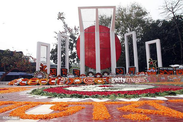 Bangladesh. 21th February 2015. . The martyr's monument Central Shaheed Minar is decorated with flowers as an homage by thousands of Bangladeshi...
