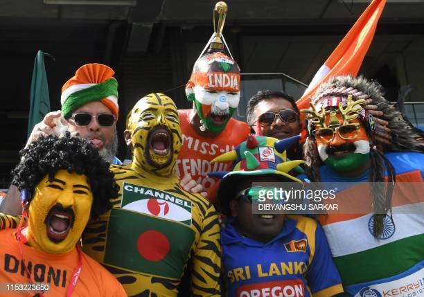 Bangladesh and Indian supporters cheer during the 2019 Cricket World Cup group stage match between Bangladesh and India at Edgbaston in Birmingham,...