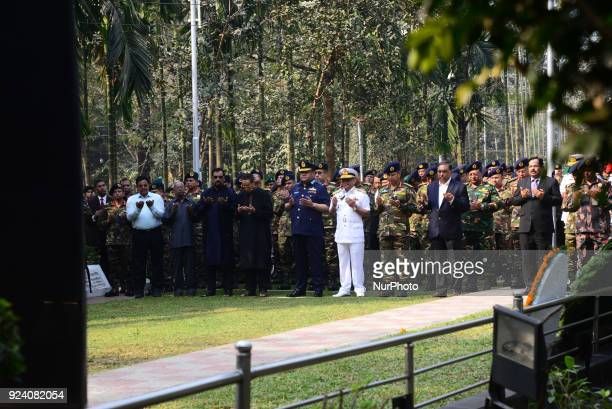Bangladesh Army Navy Air Force Border Guard's members and families of the victims' say their prayers and lay flowers on the graves of their loved...
