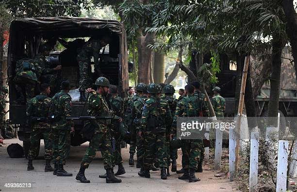 Bangladesh army personnel prepare their camp in Dhaka on December 26 2013 The armed forces have commenced their deployment on election duty until...