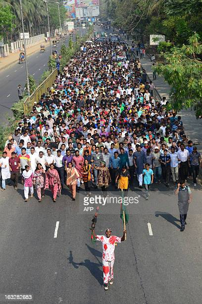 Bangladesh Awami League activists march against a strike called by the Bangladesh Nationalist Party in Dhaka on March 7 2013 Four female BNP...