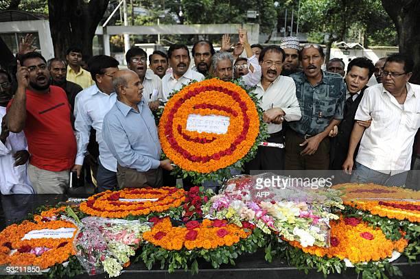 Bangladesh Awami League policital activists place floral wreaths at the former residence of Bangladesh�s founding president Sheikh Mujibur Rahman...