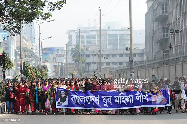 Bangladesh Awami League supporters march during a procession in Dhaka on December 30 2013 Bangladesh's capital was effectively cut off from the rest...