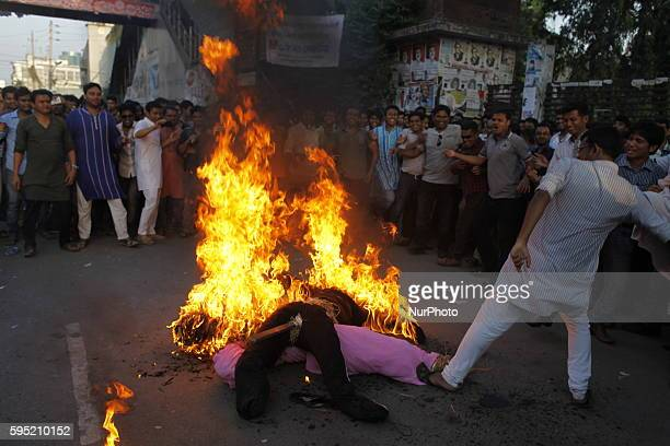 Bangladesh Awami Ligue made protest fire on Khaleda Zia Tareq Zia's effigy in front of press clubDhaka for saying 'Ziaur Rahman is the proclaimer of...