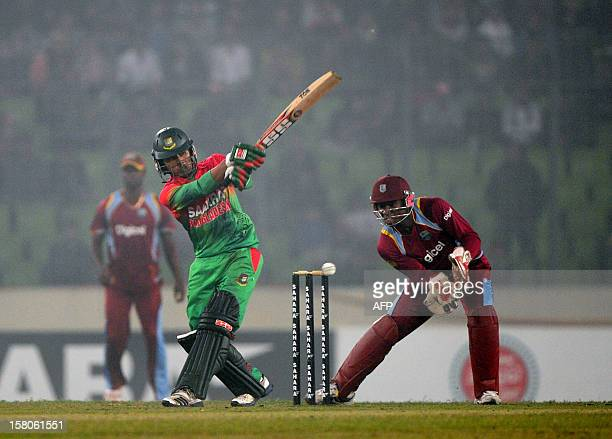 Bangladesh batsman Anamul Haque plays a shot as the West Indies wicketkeeper Devon Thomas looks on during the T20 match between Bangladesh and West...