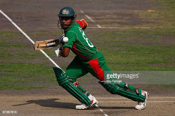 Bangladesh batsman Imral Kayes cuts a ball towards the boundary during the 2nd ODI between Bangladesh and England at Shere-e-Bangla National Stadium...