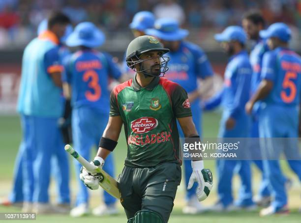 Bangladesh batsman Liton Das leaves the field after being dismissed during the one day international Asia Cup cricket match between Bangladesh and...