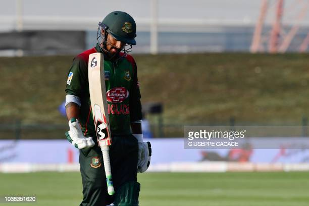 Bangladesh batsman Liton Das leaves the field after being dismissed during the one day international Asia Cup cricket match between Afghanistan and...