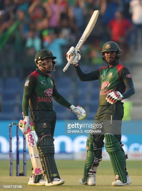 Bangladesh batsman Mohammad Mithun celebrates after scoring a halfcentury as Mushfiqur Rahim looks on during the one day international Asia Cup...